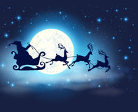Santa Claus, deers and full Moon Stock Photography