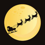 Santa claus with deers silhouette Stock Photography