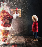 Santa Claus deliver a gift to a child Royalty Free Stock Photo