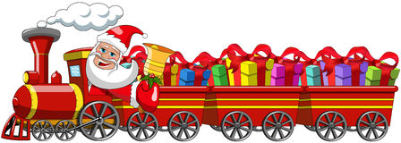 Santa Claus Delivering gifts driving steam locomotive wagons Royalty Free Stock Image