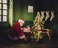 Santa Claus delivering present. Illustration of Santa Claus putting presents under a decorated tree in a home, Christmas scene Royalty Free Stock Photos