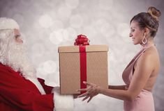 Santa Claus delivers the gift Stock Images