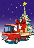 Santa Claus delivers gifts on a red truck. Royalty Free Stock Photo