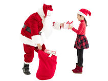 Santa claus delivery gift box to child Royalty Free Stock Photos