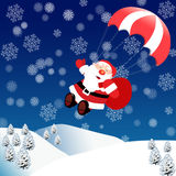 Santa Claus by descends parachute. Cheerful Santa Claus goes down from the sky on a parachute Stock Photo