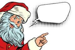 Santa Claus, die auf Kopienraum zeigt Stockfotografie