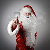 Santa Claus die de knoop duwt Royalty-vrije Stock Fotografie
