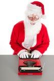 Santa Claus die een brief schrijven Stock Foto's