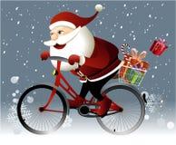 Santa Claus die een fiets berijden Stock Foto's