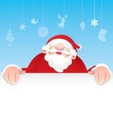 Santa Claus, die ein Zeichen hält Lizenzfreies Stockfoto