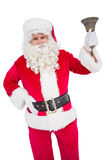 Santa Claus, die eine Glocke schellt Lizenzfreie Stockfotografie