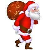 Santa Claus, die eine Tasche mit Geschenken trägt Stockfoto