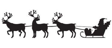 Santa Claus, die einen Pferdeschlitten mit Renen reitet Stockbilder