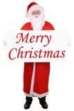 Santa Claus, die Fahne mit frohen Weihnachten lokalisiert hält Stockbilder