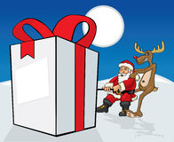 Santa Claus, die Geschenk zieht Stockfotografie