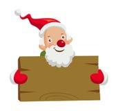 Santa Claus, die hölzernes Brett hält Stockfoto