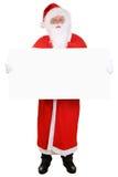 Santa Claus, die leere Fahne auf Weihnachten lokalisiert hält Stockbild