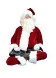 Santa Claus, die in Lotussitz schwimmt Stockfotos