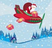 Santa Claus die over stad vliegen Stock Foto's