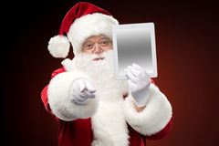 Santa Claus with digital tablet Royalty Free Stock Images