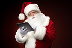 Santa Claus with digital tablet Royalty Free Stock Photography