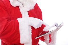 Santa Claus digital tabletdator Royaltyfria Foton
