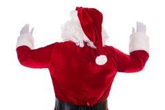 Santa Claus dio vuelta detrás Imágenes de archivo libres de regalías