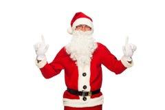 Santa Claus dirigeant le signe avec le sourire, d'isolement dessus Photographie stock