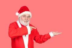 Santa Claus dirigeant quelque chose avec son doigt Photo stock