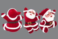 Santa Claus docka på en grå bakgrund royaltyfri illustrationer