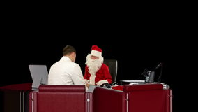 Santa Claus at Doctor, measuring blood pressure, against black, stock footage Stock Photos