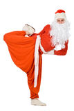 Santa Claus does gymnastics Stock Photo