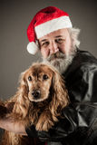 Santa Claus  with  dog Stock Photos