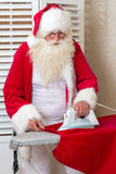 Santa Claus doing chores Stock Photography