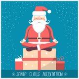 Santa claus doing yoga meditation and sitting on big present box Royalty Free Stock Photography