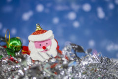 Santa Claus doll with abstract background. Royalty Free Stock Images