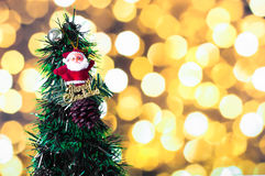 The Santa Claus doll against pine nut with ball and Christmas tree o Stock Image