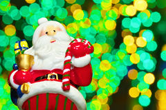 Santa Claus doll with a background of illuminations. An image of Christmas Stock Image