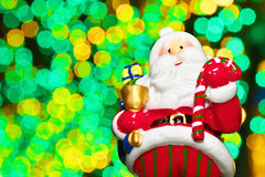 Santa Claus doll with a background of illuminations. An image of Christmas Royalty Free Stock Photos
