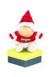 Santa Claus doll with a big gift box isolated on white backgroun Royalty Free Stock Photos