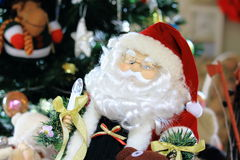 Santa Claus Doll With Blurry Christmas Decoration Behind the Scene Royalty Free Stock Photo