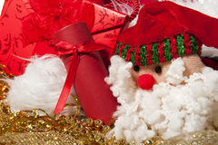 Santa Claus doll an christmas gift Stock Photos
