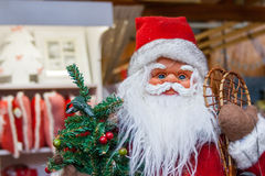 Santa Claus doll. With christmas tree Royalty Free Stock Photos