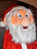 Santa Claus doll in full size. While he smiles amused stock photos