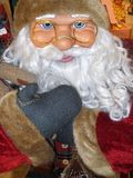 Santa Claus doll in full size. While he smiles amused stock photo
