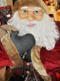 Santa Claus doll ,with glasses. Santa Claus doll in full size, while he smiles amused stock photography