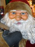 Santa Claus doll ,with glasses. Santa Claus doll in full size, while he smiles amused stock image