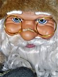 Santa Claus doll, with glasses. Santa Claus doll in full size, while he smiles amused royalty free stock photos