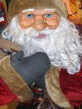 Santa Claus doll ,with glasses. Santa Claus doll in full size, while he smiles amused stock photo