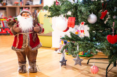 Santa Claus doll. Near a Christmas tree stock photo